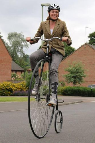 girl on penny farthing front