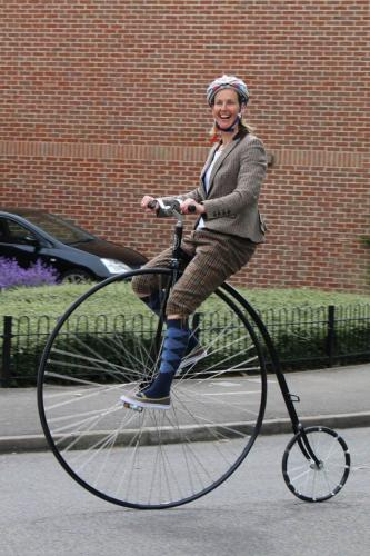 girl on penny farthing
