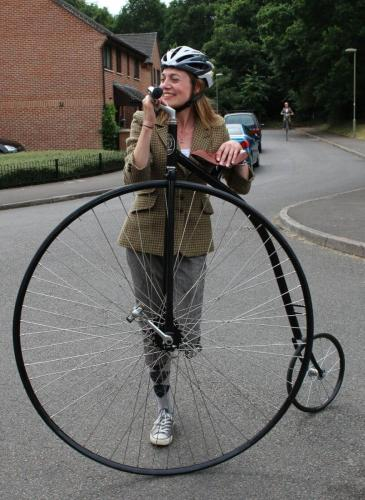 girl relaxing on penny farthing
